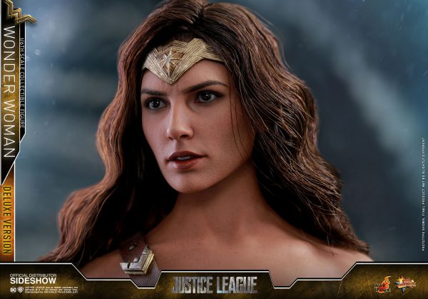 The 1/6th scale Wonder Woman (Deluxe Version) Collectible Figure specially features: - Authentic and detailed likeness of Gal Gadot as Wonder Woman in Justice League - Newly painted head sculpt with movie-accurate facial expression, make-up, and gold colored tiara - Long curly dark brown real fabric hair implantation - Body with over 17 points of articulations - Approximately 29 cm tall - Nine (9) pieces of interchangeable hands including: - One (1) pair of relaxed hands - One (1) pair of fists - One (1) pair of hands for holding Lasso of Truth - One (1) pair of hands for holding weapons - One (1) left hand for holding sword - Each piece of head sculpt is specially hand-painted Costume : - One (1) specially tailored red, blue, and gold colored Wonder Woman armor with weathering and battle damaged effect - One (1) brown colored leather-like strap - One (1) black-colored hooded robe*** - One (1) dark brown colored leather-like cross-body belt (equipped with Velcro tape)*** - One (1) pair of gold and silver colored Bracelets of Submission - One (1) pair of gold and orange colored Bracelets of Submission - One (1) pair of red and gold colored boots with weathering and battle damaged effect Weapons: - One (1) engraved sword - One (1) shield with weathering effect - One (1) piece of gold colored rope (Lasso of Truth) (attachable to the strap) - Two (2) pieces of yellow colored ropes (Lasso of Truth) Accessories: - Four (4) pieces of magnetic bullet sparkling effects in small, medium and large size (attachable to the gold and silver colored Bracelets of Submission) - One (1) Amazonian Mother Box*** - Specially designed Justice League elevating platform themed figure stand with Wonder Woman nameplate and the movie logo *** Exclusive to Deluxe Version